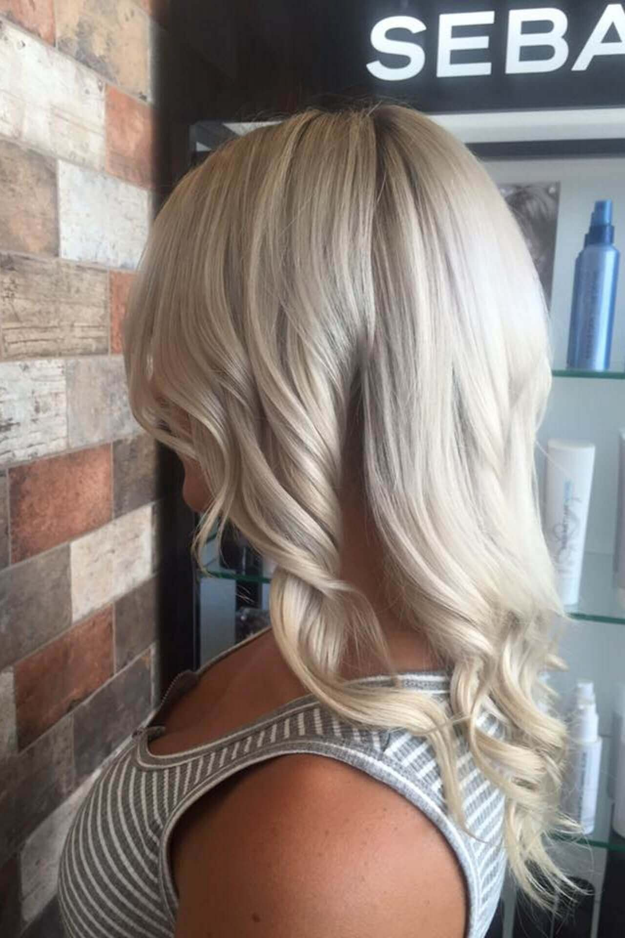 Samantha Jones Hair Co Our Work Image Gallery - White Curly Natural Hair Below the Shoulder V Cut